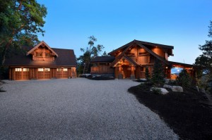 Log Home and three car garage lite up at sunset