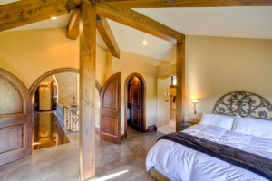 Master Bedroom with exposed finished beams
