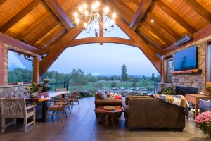 luxurious log home outdoor living room
