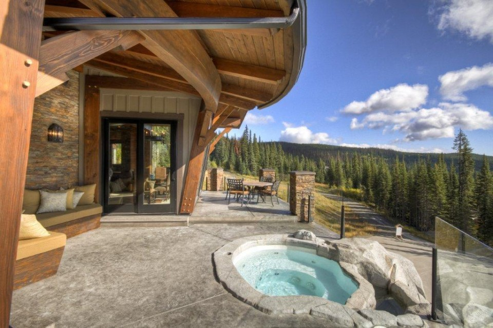 hot tub on patio over looking forest