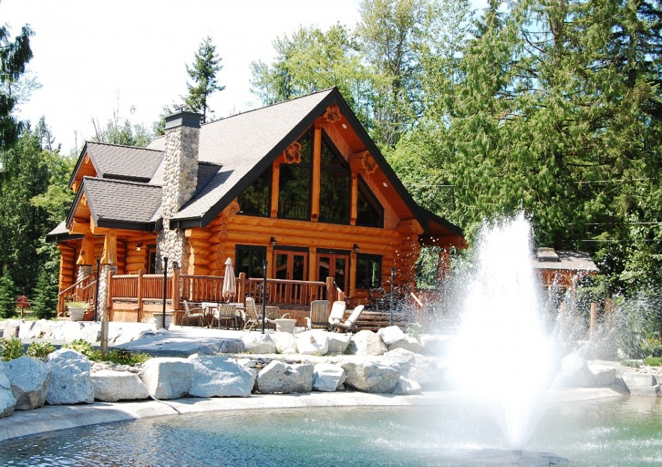 Beautiful log cabin with water feature backyard