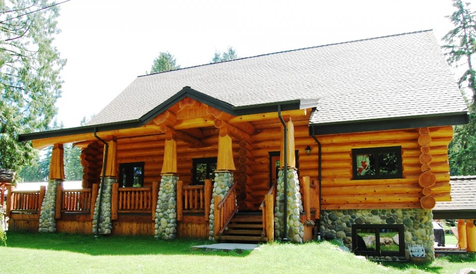 Log cabin deck with rock accents