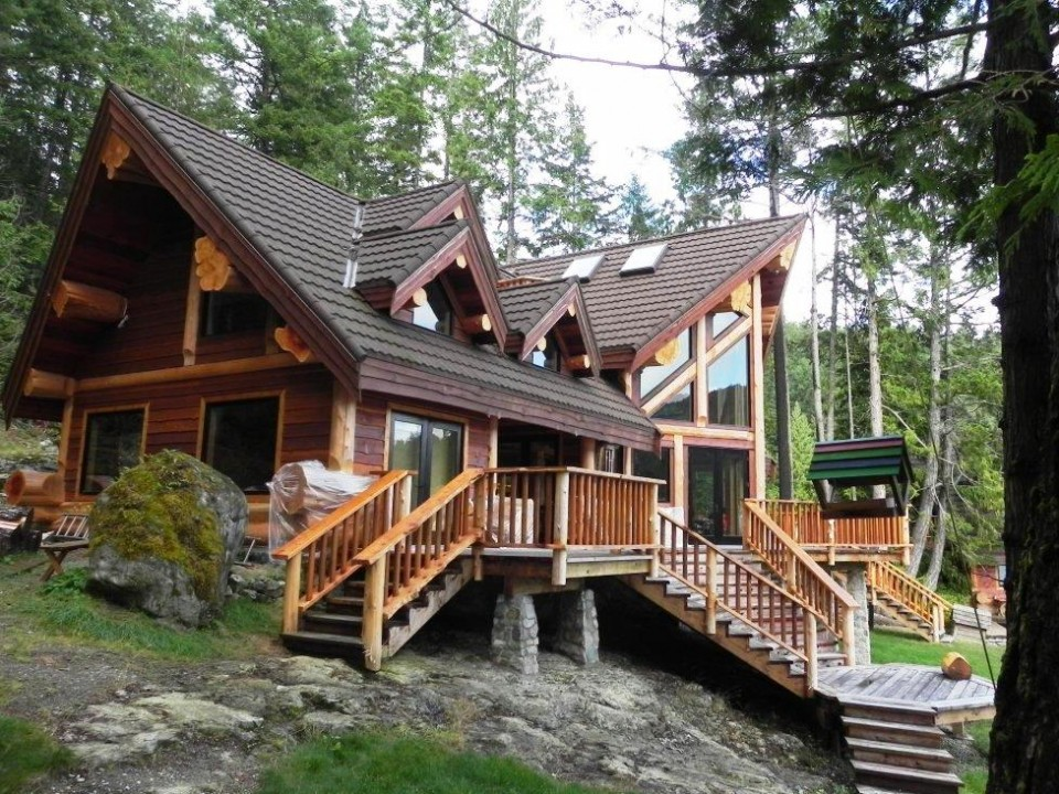 luxury log home nestled into the forest