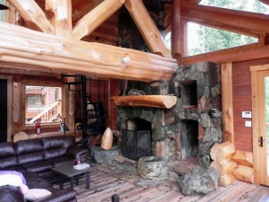 traditional log home with oversized fireplace