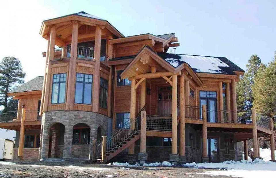 Snow capped log home