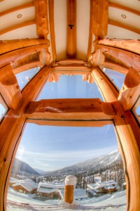 fish eye view from inside a log cabin