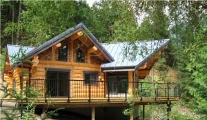 Timber Frame Log House nestled into the forrest