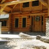 log cabin with beautiful rock entry way