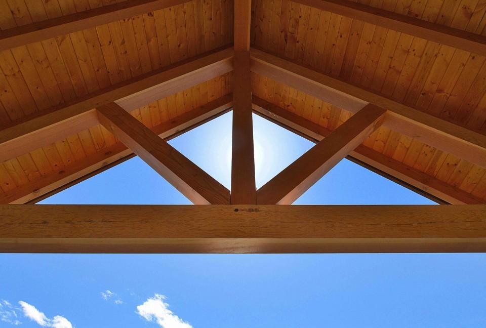 External exposed beams with blue sky behind