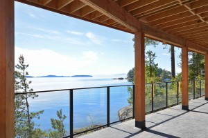 The ocean view from the deck of a modern home