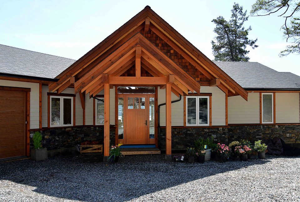 The entranceway of a modern timber frame home