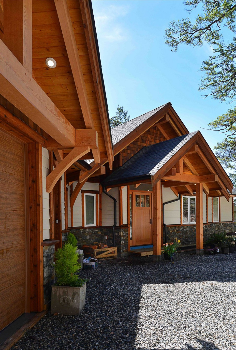 A sideview of the outside of a timber frame home