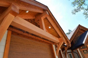 A close up of the timber frame beams above the garage