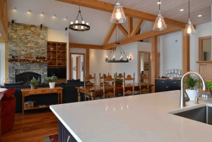 Modern kitchen countertop with dining table in the background