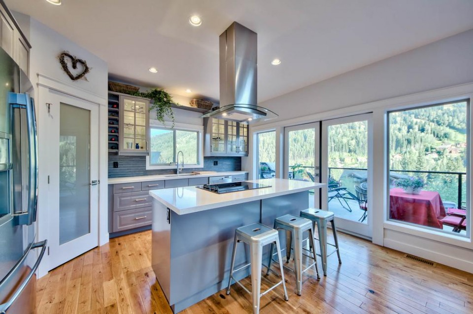Modern kitchen with wood floor looking over a view of the hills