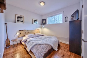 Third bedroom with wood floor in modern home