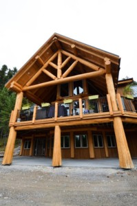 Two story covered deck on a post and beam log home