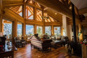 Open-concept living room in a post and beam log home