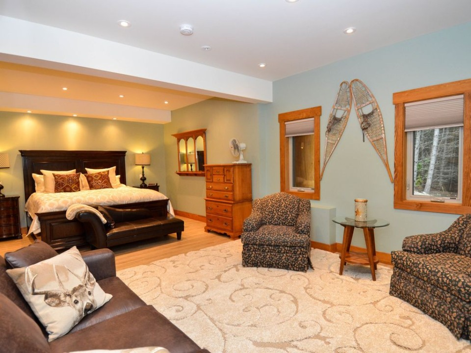 Master bedroom in a modern post and beam log home