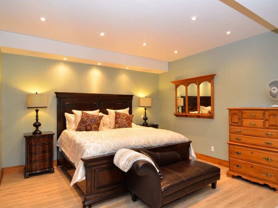 Close up of master bed in post and beam log home