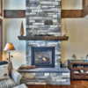 Close-up of the stone fireplace in a timber frame log home