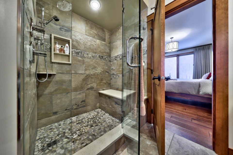 Glass shower in a timber frame log home