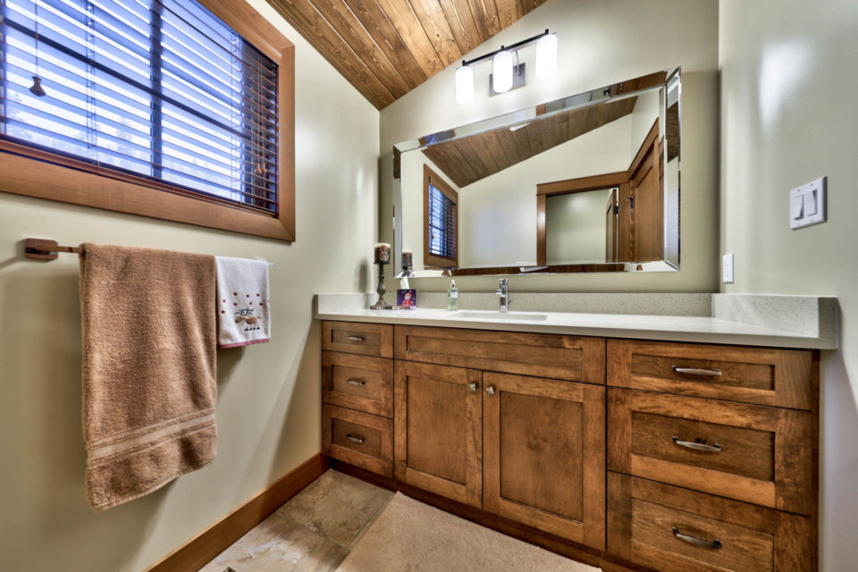Vanity in the second bathroom of a timber frame log home