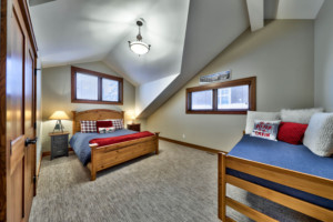 Second bedroom with vaulted ceilings in a timber frame log home