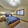Third bedroom with vaulted ceilings in a timber frame log home
