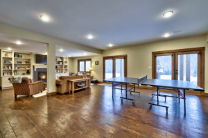 Rec room with ping pong table in timber frame log home