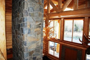 stone-flkoor-to-ceiling-fireplace