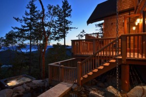Timber Frame Home lite up at sunset