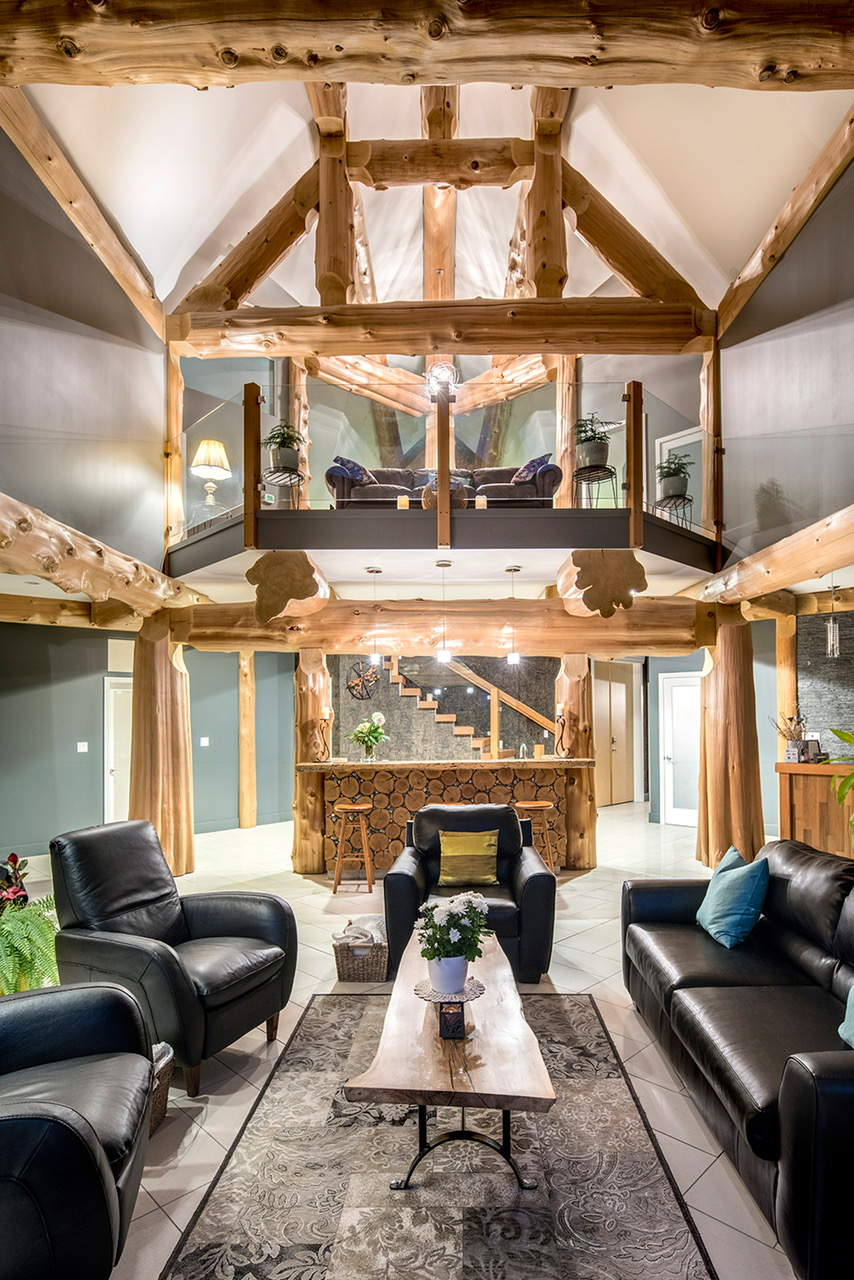great-room-with-vaulted-ceilings-with-exposed-log-beams