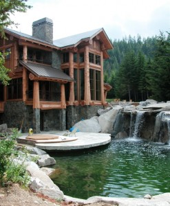 Exterior Timber Frame Home overlooking water fall and pool
