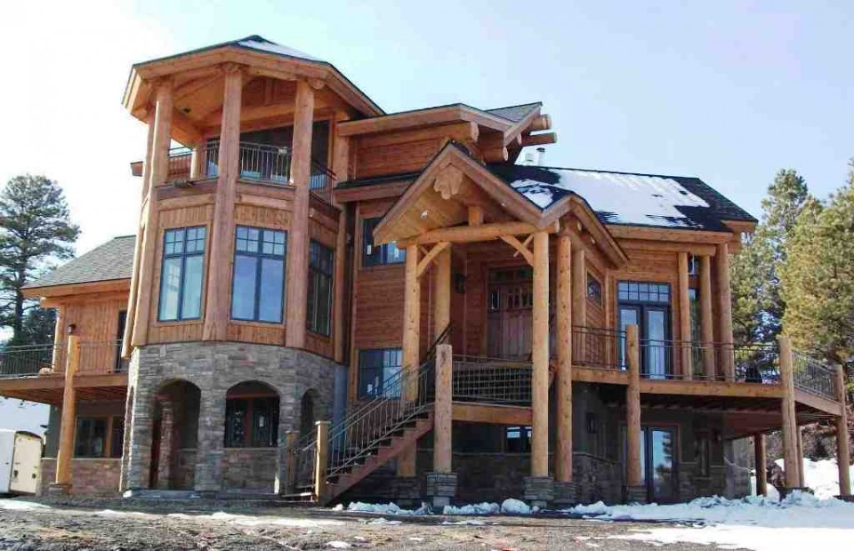 Snow capped log home