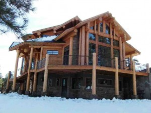 snow covered log home