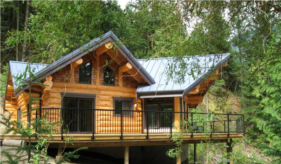Timber Frame Log House nestled into the forrest