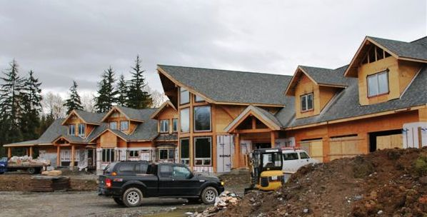 large luxury timber frame home under construction