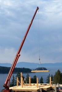 Log boom lowering beam into place