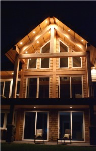 West Coast style home lite up at night