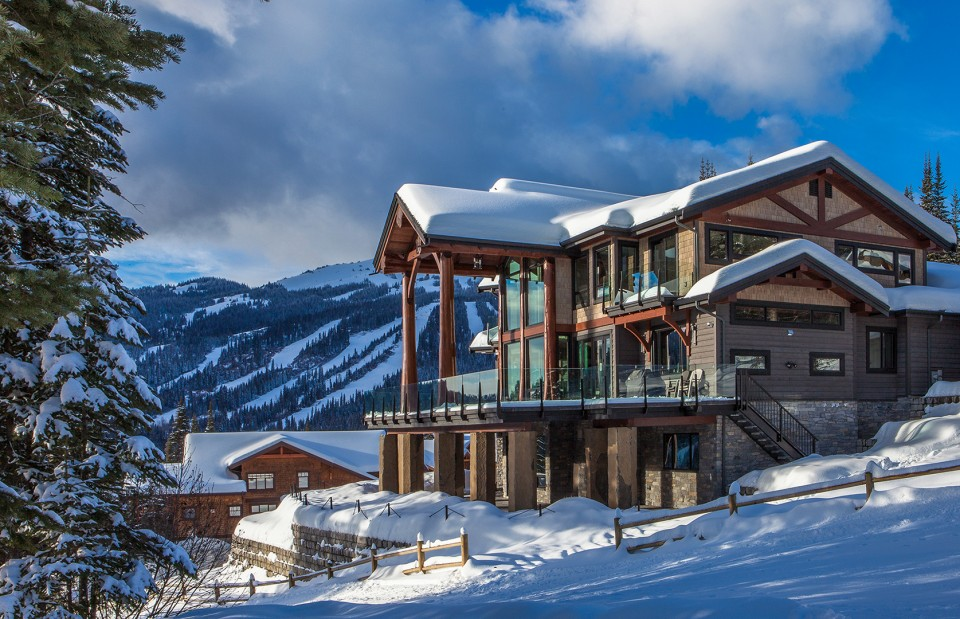 snow-covered-timber-frame-house