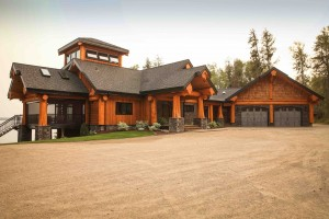 driveway-and-garage-view-of-log-home