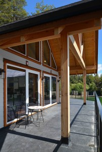 The deck and exposed beams outside a timber frame home