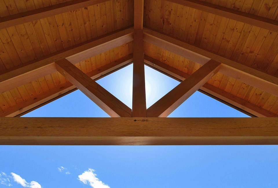 External exposed beams with blue sky behind