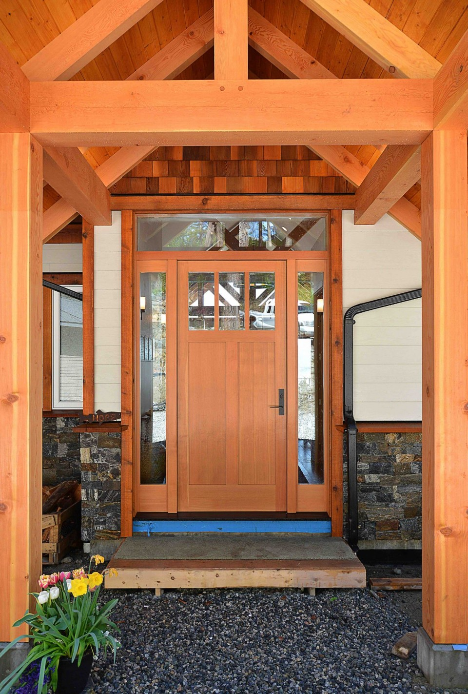 The wood door of a timber frame home