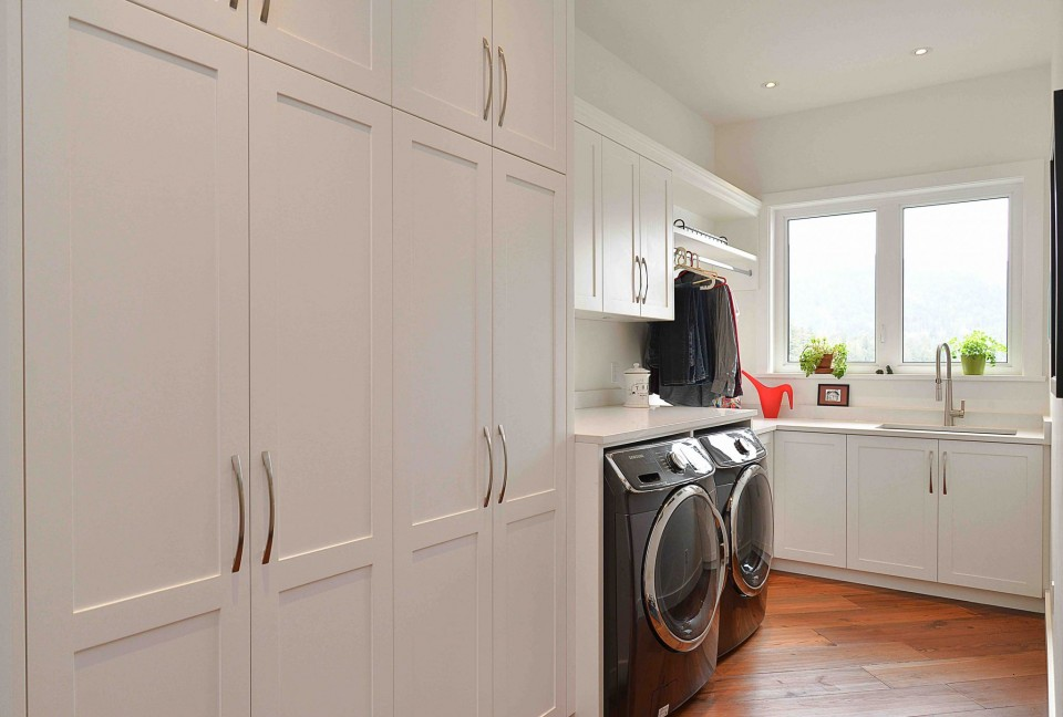 Laundry room with lots of cabinets