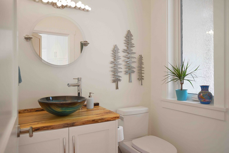 Bathroom with modern sink and wall decorations