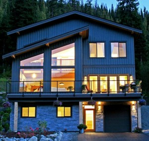 Outside of a timber frame home in the dark