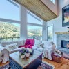 Modern living room looking over a view of the hills
