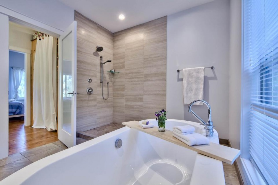 View of the modern shower from the soaker tub in the master bathroom
